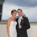 130x130 sq 1481034489624 bride and groom with odell building close up