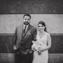 130x130 sq 1481903511497 bride and groom against wall black and white