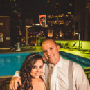 130x130 sq 1481909385357 bride and groom with pool at night