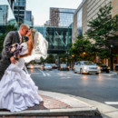 130x130 sq 1483972951277 bride and groom kissing on the corner