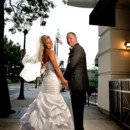 130x130 sq 1483973029195 bride and groom under the holiday inn sign