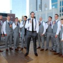 130x130 sq 1483999937302 groom in front with groomsmen jackets off