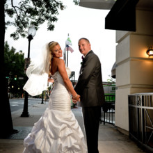 220x220 sq 1494435977611 bride and groom under the holiday inn sign