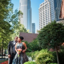 220x220 sq 1494436528814 bride and groom kissing with skyscrapper