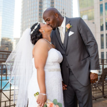 220x220 sq 1494436778206 bride and groom kissing with skyscrapper close up