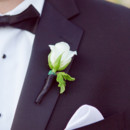 Groom and Groomsmen Attire: Black Tie Tuxedos and Couture Menswear  Floral Designer: Seasons Floral Design