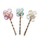 Amanda Rudey Flower Bobby Pin ~ Each bobby pin is topped off with a beautiful little gemstone flower with freshwater pearls. Available in white or gray pearl or any color gemstone you would like! Available in 18k vermeil, Sterling Silver or 14k Gold.