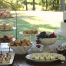 Beautiful farm wedding dessert table. very simple cake accented with fresh fruit and a bounty of petite sweets.