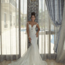 Juno  Dress with multiple combined French laces crochet. Sheer back detail and triple tulle train and various lace trims.