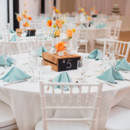 Event Planner: Carolyn Poggioli  Reception Venue/Caterer: Skybox Event Center  Floral Designer: Sullivan Owen Floral & Event Design