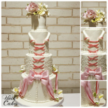 220x220 sq 1414179806389 wedding cake with bow and flowers
