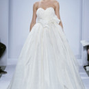 Style 32810467  This ball gown features a sweetheart neckline with a natural waist in silk. It has a chapel train. This gown is Exclusive to Kleinfeld Bridal.