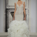 Style 32990947  This mermaid gown features a sweetheart neckline with a dropped waist in silk organza and beaded embroidery. It has a chapel train and cap sleeves. This gown is Exclusive to Kleinfeld Bridal.