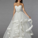 Style 32848228  This ball gown features a sweetheart neckline with an empire waist in organza and beaded embroidery. It has a chapel train. This gown is Exclusive to Kleinfeld Bridal.