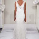 Style 32637530  This sheath gown features a v-neck neckline with in beaded embroidery and silk. It has a sweep train and a tank top. This gown is Exclusive to Kleinfeld Bridal.