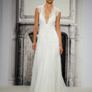 Style 32813719This sheath gown features a v-neck neckline with in lace. It has a sweep train and cap sleeves. This gown is Exclusive to Kleinfeld Bridal.