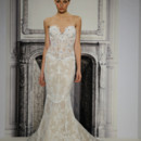 Style 33010851 This mermaid gown features a sweetheart neckline with in beaded lace. It has a chapel train. This gown is Exclusive to Kleinfeld Bridal.