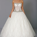 Style # 32708950 This ball gown features a strapless neckline with a natural waist in lace and beaded embroidery. It has a chapel train. This gown is Exclusive to Kleinfeld Bridal.