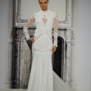 Style # 32813735 This sheath gown features an high neck neckline with in chiffon and beaded lace. It has a chapel train and long sleeves. This gown is Exclusive to Kleinfeld Bridal.