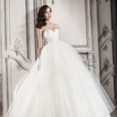 Style # 32848202 This ball gown features a sweetheart neckline with an empire waist in tulle and satin. It has a chapel train. This gown is Exclusive to Kleinfeld Bridal.