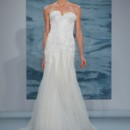 Style 110  Strapless gown with beaded one-dimensional floral lace bodice amd illusion flounce