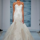 Style 124  Cord embroidered organza strapless gown with nude side panels and flounce