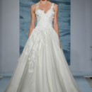 Style 106  Strapless ball gown of silk satin-faced organza with embroidered swirl motifs