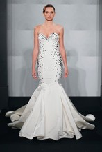Style 32593519  This mermaid gown features a sweetheart neckline with a dropped waist in silk faille. It has a chapel train. This gown is Exclusive to Kleinfeld Bridal.