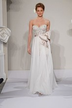 Style 33009705  This a-line gown features a sweetheart neckline with a natural waist in silk chiffon and beaded embroidery. It has a chapel train. This gown is Exclusive to Kleinfeld Bridal.