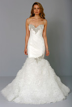 Style 32659955  This mermaid gown features a sweetheart neckline with a dropped waist in organza and beaded embroidery. It has a chapel train and spaghetti straps. This gown is Exclusive to Kleinfeld Bridal.