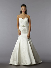 Style  This mermaid gown features a sweetheart neckline with a natural waist in satin and lace. It has a sweep train. This gown is available in Plus Sizes, and is Exclusive to Kleinfeld Bridal.