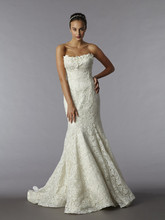 Style 32679821 This mermaid gown features a strapless neckline with in lace. It has a chapel train. This gown is Exclusive to Kleinfeld Bridal.
