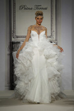 Style 32813693  This ball gown features a sweetheart neckline with a natural waist in lace. It has a chapel train and long sleeves. This gown is Exclusive to Kleinfeld Bridal.