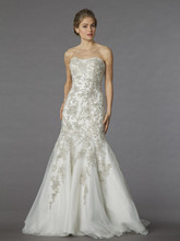 Style 32838237  This mermaid gown features a strapless neckline with a dropped waist in beaded embroidery and tulle. It has a chapel train. This gown is Exclusive to Kleinfeld Bridal.