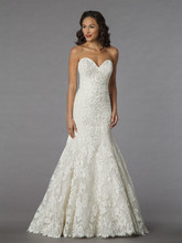 Style 32851701  This mermaid gown features a sweetheart neckline with a dropped waist in lace and tulle. It has a chapel train. This gown is available in Plus Sizes, and is Exclusive to Kleinfeld Bridal.