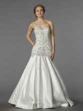 Style 33012030  This mermaid gown features a sweetheart neckline with a dropped waist in beaded embroidery and satin. It has a chapel train. This gown is Exclusive to Kleinfeld Bridal.