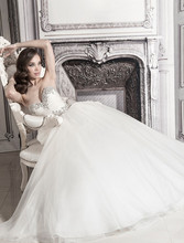 Style 32848194  This ball gown features a sweetheart neckline with an empire waist in tulle and beaded embroidery. It has a chapel train. This gown is Exclusive to Kleinfeld Bridal.