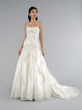 Style 32950271  This a-line gown features a strapless neckline with in beaded lace and organza. It has a chapel train. This gown is Exclusive to Kleinfeld Bridal.