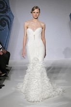 Style 32555781  This mermaid gown features a sweetheart neckline with a dropped waist in chiffon. It has a chapel train. This gown is Exclusive to Kleinfeld Bridal.