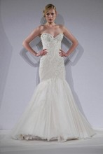 Style 32697245  This mermaid gown features a sweetheart neckline with a dropped waist in tulle and beaded embroidery. It has a chapel train. This gown is Exclusive to Kleinfeld Bridal.