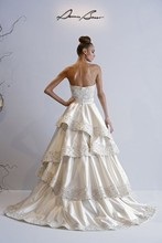 Style 32593634  This a-line gown features a strapless neckline with a natural waist in silk satin and beaded embroidery. It has a chapel train. This gown is Exclusive to Kleinfeld Bridal.