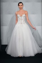 Style 32775553  This a-line gown features a sweetheart neckline with a natural waist in tulle and beaded embroidery. It has a cathedral train. This gown is Exclusive to Kleinfeld Bridal.