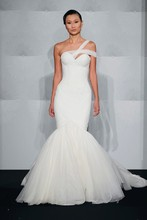 Style 32694952  This mermaid gown features an asymmetric neckline with a dropped waist in tulle. It has a chapel train. This gown is Exclusive to Kleinfeld Bridal.