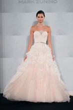 Style 32753295  This ball gown features a sweetheart neckline with a natural waist in silk chiffon and silk organza. It has a chapel train. This gown is Exclusive to Kleinfeld Bridal.