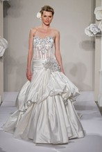 Style 32637563 < br> This ball gown features a sweetheart neckline with a dropped waist in silk taffeta. It has a chapel train. This gown is Exclusive to Kleinfeld Bridal.