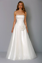 Style 32729907  This a-line gown features a strapless neckline with a natural waist in silk. It has a chapel train. This gown is Exclusive to Kleinfeld Bridal.