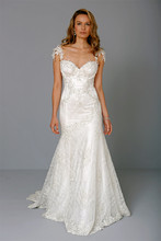 Style 32933053  This mermaid gown features a sweetheart neckline with in beaded lace. It has a chapel train and cap sleeves. This gown is Exclusive to Kleinfeld Bridal.