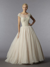 Style 32769598  This ball gown features a bateau neckline with a natural waist in tulle and beaded embroidery. It has a sweep train and cap sleeves. This gown is Exclusive to Kleinfeld Bridal.