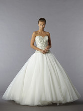Style 32777773  ball gown features a sweetheart neckline with a dropped waist in tulle and beaded embroidery. It has a sweep train. This gown is Exclusive to Kleinfeld Bridal.