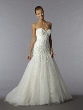 Style 32908253  This mermaid gown features a sweetheart neckline with a dropped waist in tulle. It has a chapel train. This gown is Exclusive to Kleinfeld Bridal.